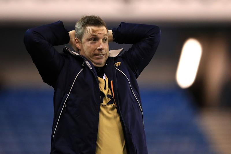 Millwall manager Neil Harris watches his side beat Bournemouth 3-0 in round 3