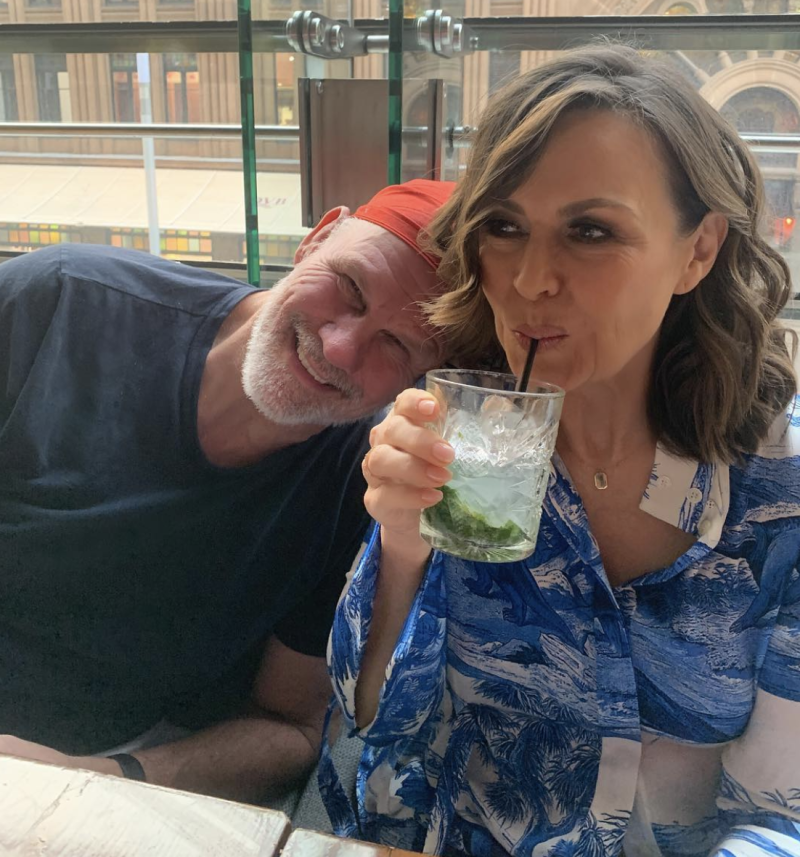 Lisa Wilkinson and Peter FitzSimons sitting next to one another at a restaurant