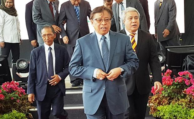 Datuk Patinggi Abang Johari Openg (centre) said that 30,000 jobs and RM18 billion in investment opportunities could be generated throughout the entire biomass value chain. — Picture by Sulok Tawie