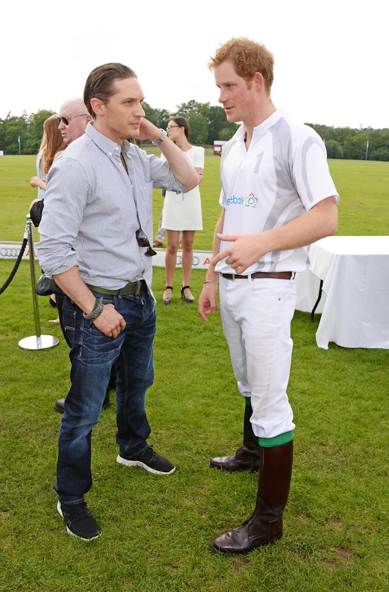 Tom Hardy and Prince Harry chat at the Audi Polo Challenge on June 1, 2014, in Ascot, England. (David M. Benett via Getty Images)