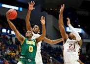 <p>Stef Smith #0 of the Vermont Catamounts goes up for a shot in front of M.J. Walker #23 and Trent Forrest #3 of the Florida State Seminoles during their first round game of the 2019 NCAA Men's Basketball Tournament at XL Center on March 21, 2019 in Hartford, Connecticut. (Photo by Maddie Meyer/Getty Images) </p>