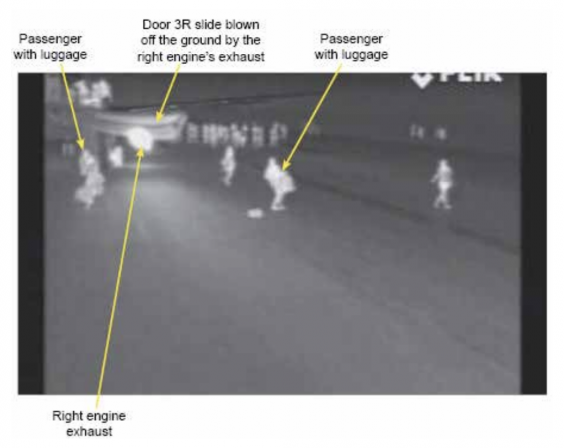Bad practice: an infra-red photograph of the evacuation scene at Stansted airport in which passengers took cabin baggage off the plane (AAIB)