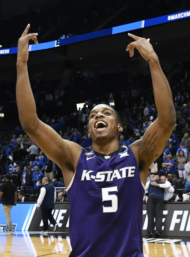 Kansas State guard Barry Brown celebrates a win over Kentucky after a regional semifinal NCAA college basketball tournament game, Friday, March 23, 2018, in Atlanta. Kansas State won 61-58. (AP Photo/John Amis)