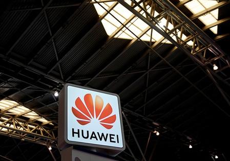 FILE PHOTO: A Huawei company logo is seen at the security exhibition in Shanghai