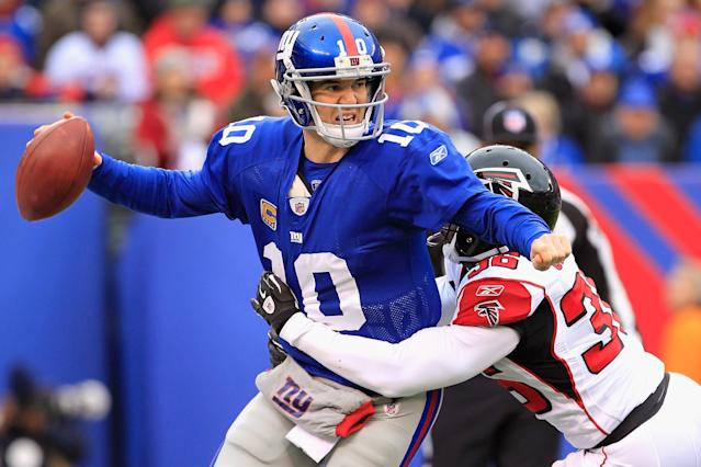 EAST RUTHERFORD, NJ - JANUARY 08: James Sanders #36 of the Atlanta Falcons tackles Eli Manning #10 of the New York Giants for a safety as Manning was called for intentianal grounding in the end zone in the first quarter during their NFC Wild Card Playoff game at MetLife Stadium on January 8, 2012 in East Rutherford, New Jersey. (Photo by Chris Trotman/Getty Images)
