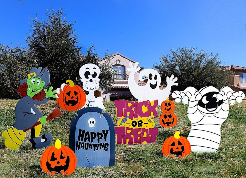 <p>For a cheerful vibe, get these <span>Joyin Friendly Halloween Corrugate Yard Stake Signs</span> ($14, set of nine).</p>