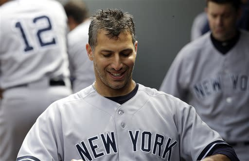 New York Yankees starting pitcher Andy Pettitte smiles in the dugout after the seventh inning of a baseball game against the Seattle Mariners, Saturday, June 8, 2013, in Seattle. Pettitte eared the win as the Yankees defeated the Mariners 3-1. (AP Photo/Ted S. Warren)