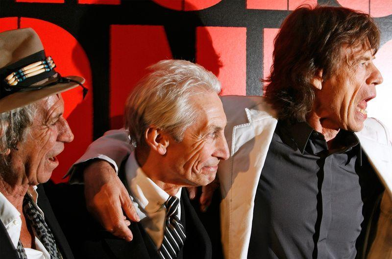 """Rolling Stones band members Keith Richards (L), Mick Jagger (R), and Charlie Watts arrive at the premiere of the documentary film """"Shine A Light"""", directed by Martin Scorsese about the Rolling Stones, in New York"""