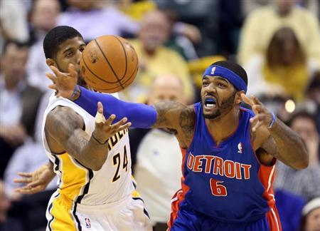 Dec 16, 2013; Indianapolis, IN, USA; Indiana Pacers forward Paul George (24) guards Detroit Pistons forward Josh Smith (6) at Bankers Life Fieldhouse. Detroit defeats Indiana 101-96. Mandatory Credit: Brian Spurlock-USA TODAY Sports - RTX16LNP