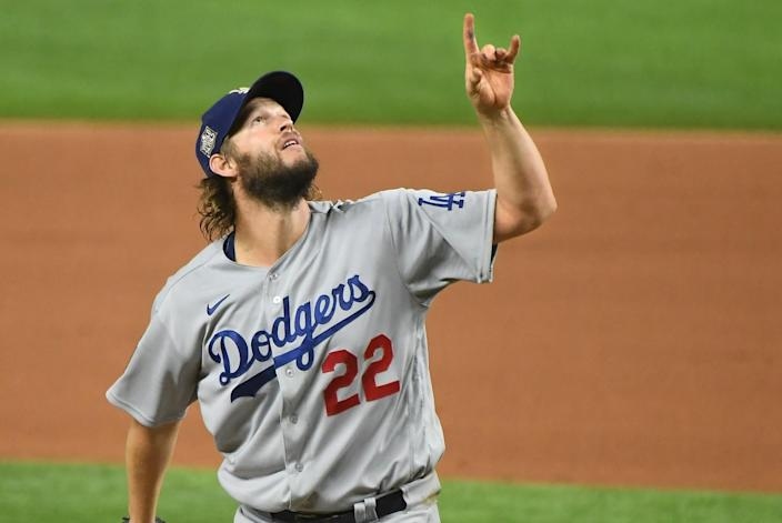 Dodgers pitcher Clayton Kershaw points to the sky as a Rays hitter pops-up.