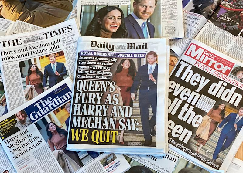 Newspapers featuring headlines about Meghan Markle and Prince Harry quitting the royals