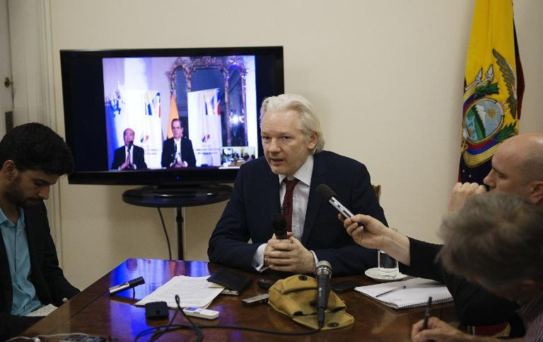 In a picture released by Sunshine Press Productions on June 19, 2014 WikiLeaks founder Julian Assange speaks to members of the media during a press conference inside the Ecuadorian Embassy