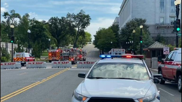Police car and ambulances stationed near US Capitol as authorities investigate 'bomb threat'