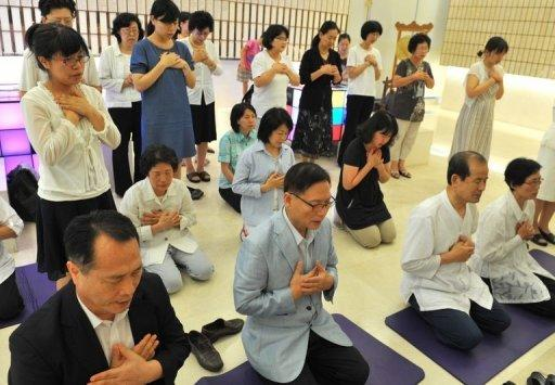 Unification Church followers hold a memorial service mourning the death of their leader Sun Myung Moon in the church's Seoul headquarters on September 3. While it claims a worldwide following of three million, experts suggest the core membership is far smaller