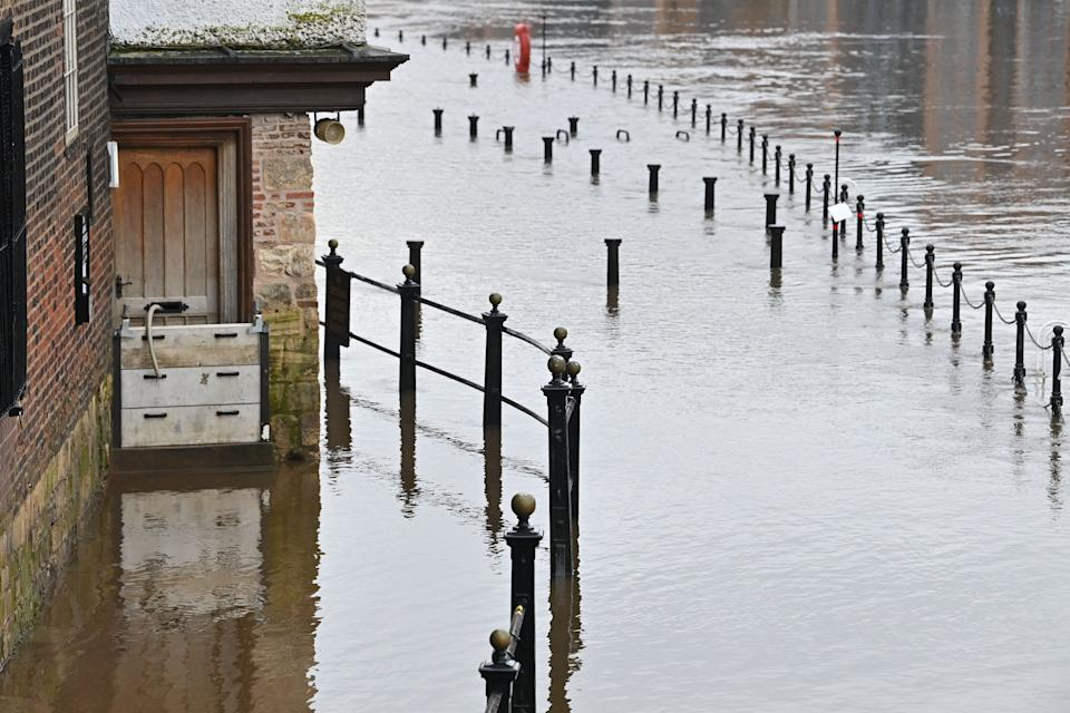 Flood defences and a hose are seen at the back door of a pub in York, northern England, on January 19, 2021 as Storm Christoph brings heavy rains across England. (Photo by Paul ELLIS / AFP) (Photo by PAUL ELLIS/AFP via Getty Images)