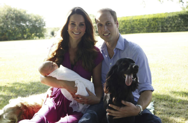 This image taken by Michael Middleton, the Duchess's father, in early August 2013 and supplied by Kensington Palace, shows the Duke and Duchess of Cambridge with their son, Prince George, in the garden of the Middleton family home in Bucklebury, England, with Tilly the retriever, seen left, a Middleton family pet, and Lupo, the couple's cocker spaniel. (AP Photo/Michael Middleton/TRH The Duke and Duchess of Cambridge ) EDITORIAL USE ONLY