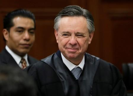 FILE PHOTO: Mexico's new Supreme Court judge Medina Mora arrives to attend an official welcoming ceremony for him at the Supreme Court building in Mexico City