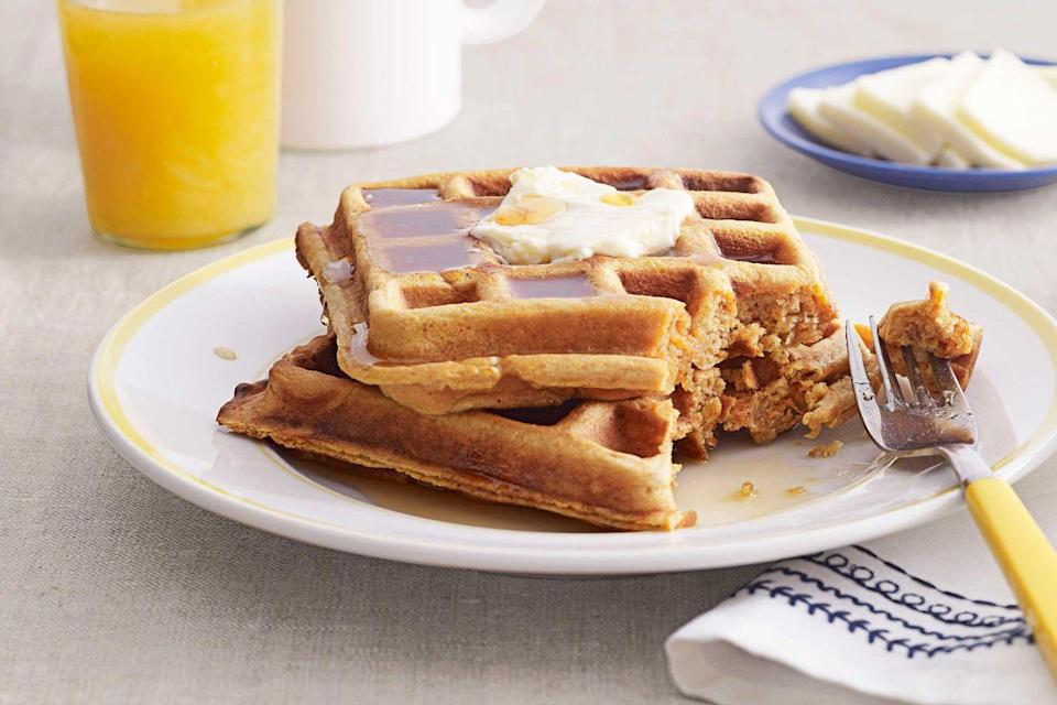 """<p>Grate orange into the waffle batter for extra zest.</p><p><strong><a href=""""https://www.countryliving.com/food-drinks/recipes/a3716/sweet-potato-waffles-recipe-clx1111/"""" rel=""""nofollow noopener"""" target=""""_blank"""" data-ylk=""""slk:Get the recipe"""" class=""""link rapid-noclick-resp"""">Get the recipe</a>.</strong></p>"""