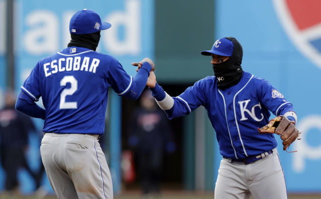 Kansas City Royals' Alcides Escobar, left, and Ryan Goins celebrate after the Royals defeated the Cleveland Indians 1-0 in a baseball game, Saturday, April 7, 2018, in Cleveland. (AP Photo/Tony Dejak)