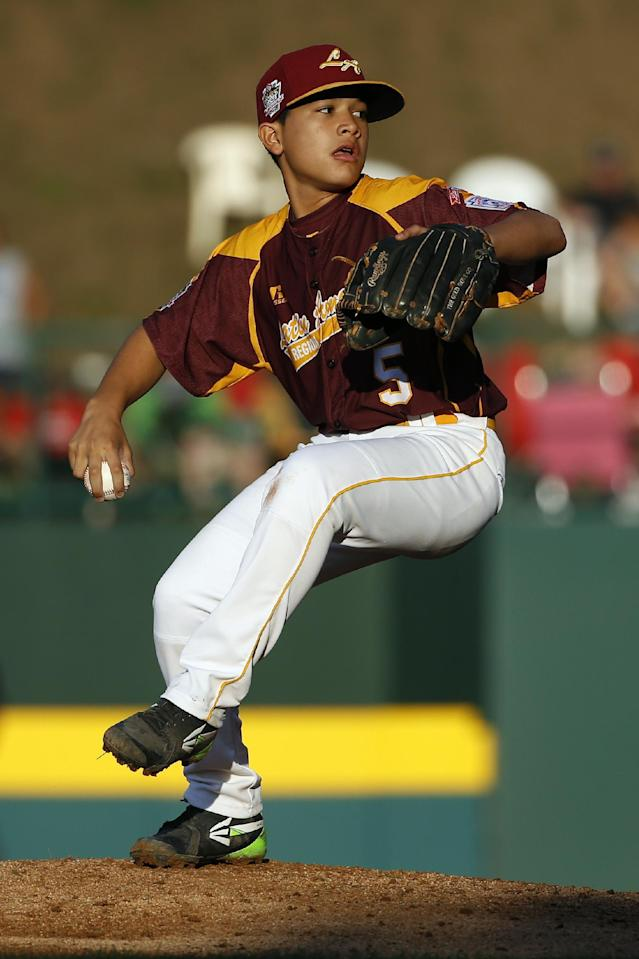 Venezuela's Ronny Medina pitches during the second inning of an International elimination baseball game against Puerto Rico at the Little League World Series, Monday, Aug. 18, 2014, in South Williamsport, Pa. Venezuela won 2-1. (AP Photo/Matt Slocum)