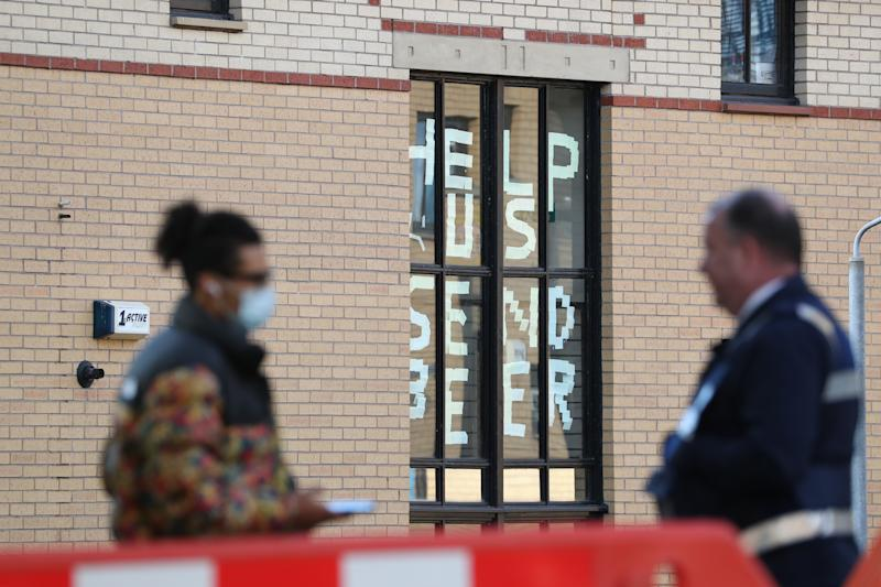 A sign saying 'help us, send beer' at Murano Street Student Village in Glasgow, where Glasgow University students are being tested at a pop up test centre. (PA)