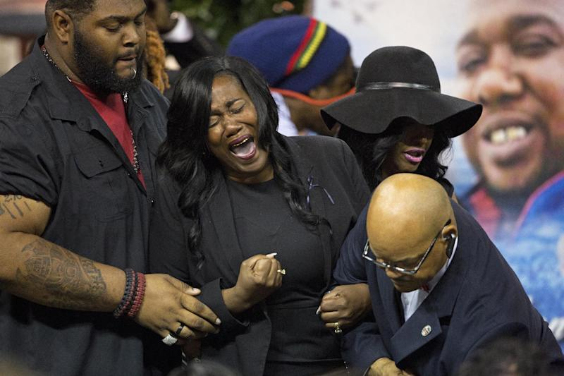 Sandra Sterling, the aunt of Alton Sterling cries out after viewing his body at the F.G. Clark Activity Center in Baton Rouge, La., Friday, July 15, 2016. Alton Sterling was shot July 5 outside a Baton Rouge convenience store in an encounter with police that was caught on video. (AP Photo/Max Becherer)