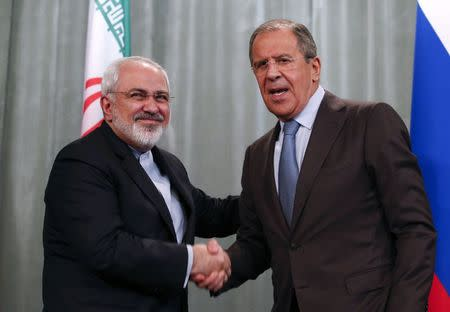 Iranian Foreign Minister Mohammad Javad Zarif and his Russian counterpart Sergei Lavrov attend a news conference in Moscow