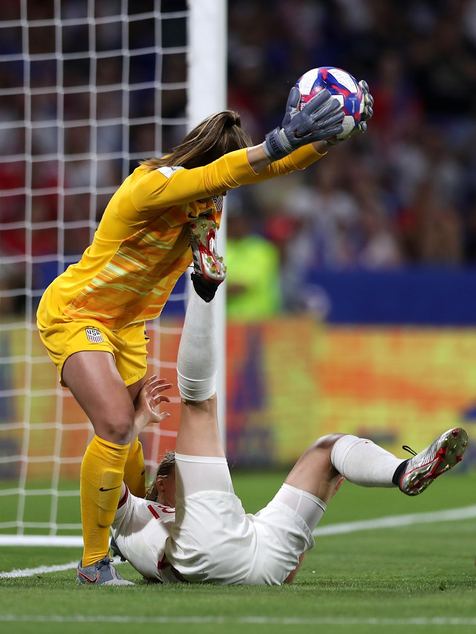 Alyssa Naeher of the USA catches the ball under pressure from Ellen White of England during the 2019 FIFA Women's World Cup France Semi Final match between England and USA at Stade de Lyon on July 02, 2019 in Lyon, France. (Photo by Naomi Baker - FIFA/FIFA via Getty Images)