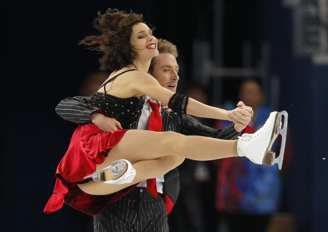 Nathalie Pechalat and Fabian Bourzat of France compete in the ice dance short dance figure skating competition at the Iceberg Skating Palace during the 2014 Winter Olympics, Sunday, Feb. 16, 2014, in Sochi, Russia