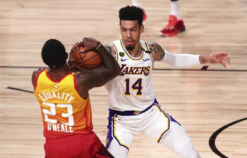 Utah Jazz forward Royce O'Neale (23) holds the ball away from Los Angeles Lakers guard Danny Green (14) during the second half of an NBA basketball game Monday, Aug. 3, 2020, in Lake Buena Vista, Fla. (Kim Klement/Pool Photo via AP)
