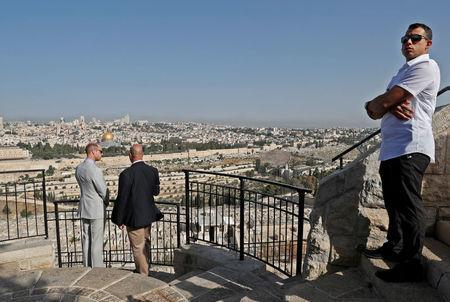 Britain's Prince William speaks to British Consul General in Jerusalem Phillip Hall during a visit to an observation point on Mount of Olives, overlooking Jerusalem's Old City, June 28, 2018. Thomas Coex/Pool via Reuters