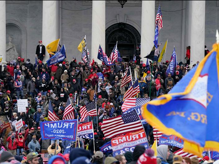 Rioters at the US Capitol on 6 January (AFP via Getty Images)