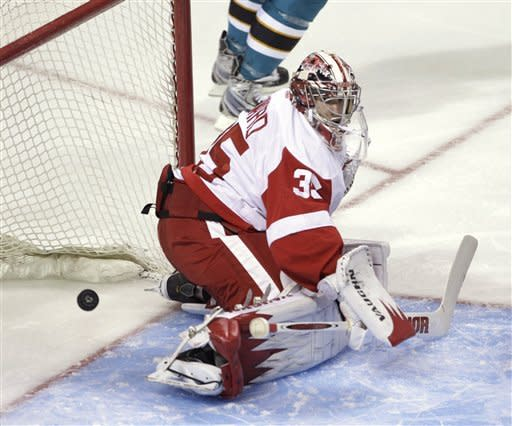 Detroit Red Wings goalie Jimmy Howard lets in a goal by San Jose Sharks' Joe Pavelski in the first period of an NHL hockey game in San Jose, Calif., Saturday, March 17, 2012. (AP Photo/Paul Sakuma)