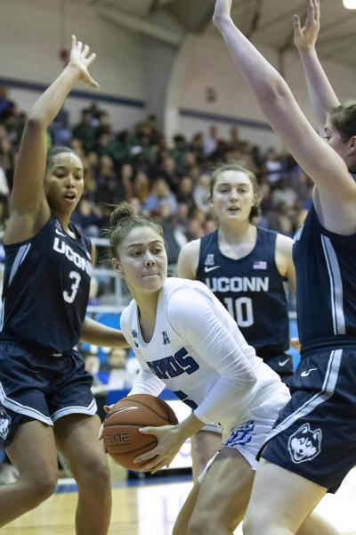 Memphis guard Aerial Wilson, center, looks to pass defended by Connecticut Megan Walker (3), guard Molly Bent (10) and forward Kayla Irwin, right, in the first half of an NCAA college basketball game Tuesday, Jan. 14, 2020, in Memphis, Tenn. (AP Photo/Nikki Boertman)
