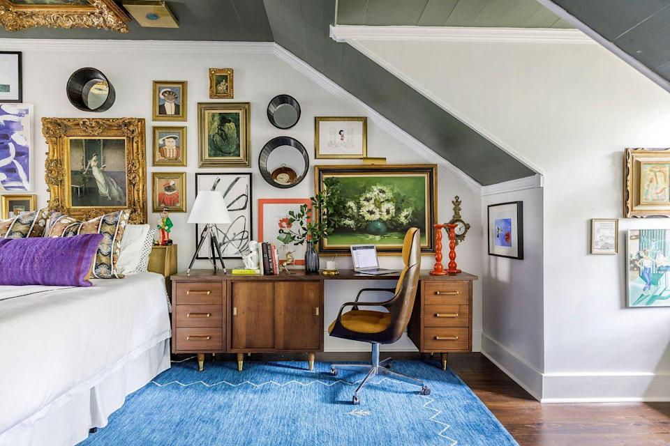 """<p>When you don't have a view or even a window to look out from your desk, cover the walls in invigorating, colorful artwork like <a href=""""https://www.krystalmatthews.com/"""" rel=""""nofollow noopener"""" target=""""_blank"""" data-ylk=""""slk:Krystal Matthews"""" class=""""link rapid-noclick-resp"""">Krystal Matthews</a> did here in her daughter's bedroom, where she studies from home. </p>"""