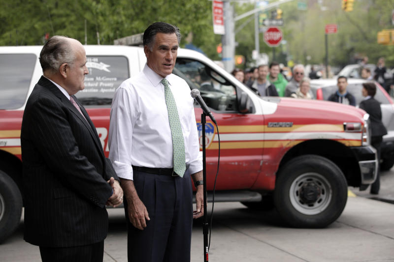 Republican presidential candidate, former Massachusetts Gov. Mitt Romney, accompanied by former New York City Mayor Rudy Giuliani, talks to reporters in front of Engine 24, Ladder 5 in New York, Tuesday, May 1, 2012. (AP Photo/Jae C. Hong)