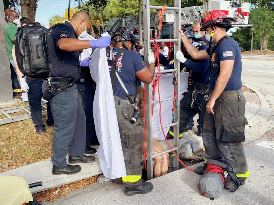 <p>Image from the scene as firefighters rescued Lyndsey Kennedy from the storm drain</p> ((Delray Beach Fire Rescue))