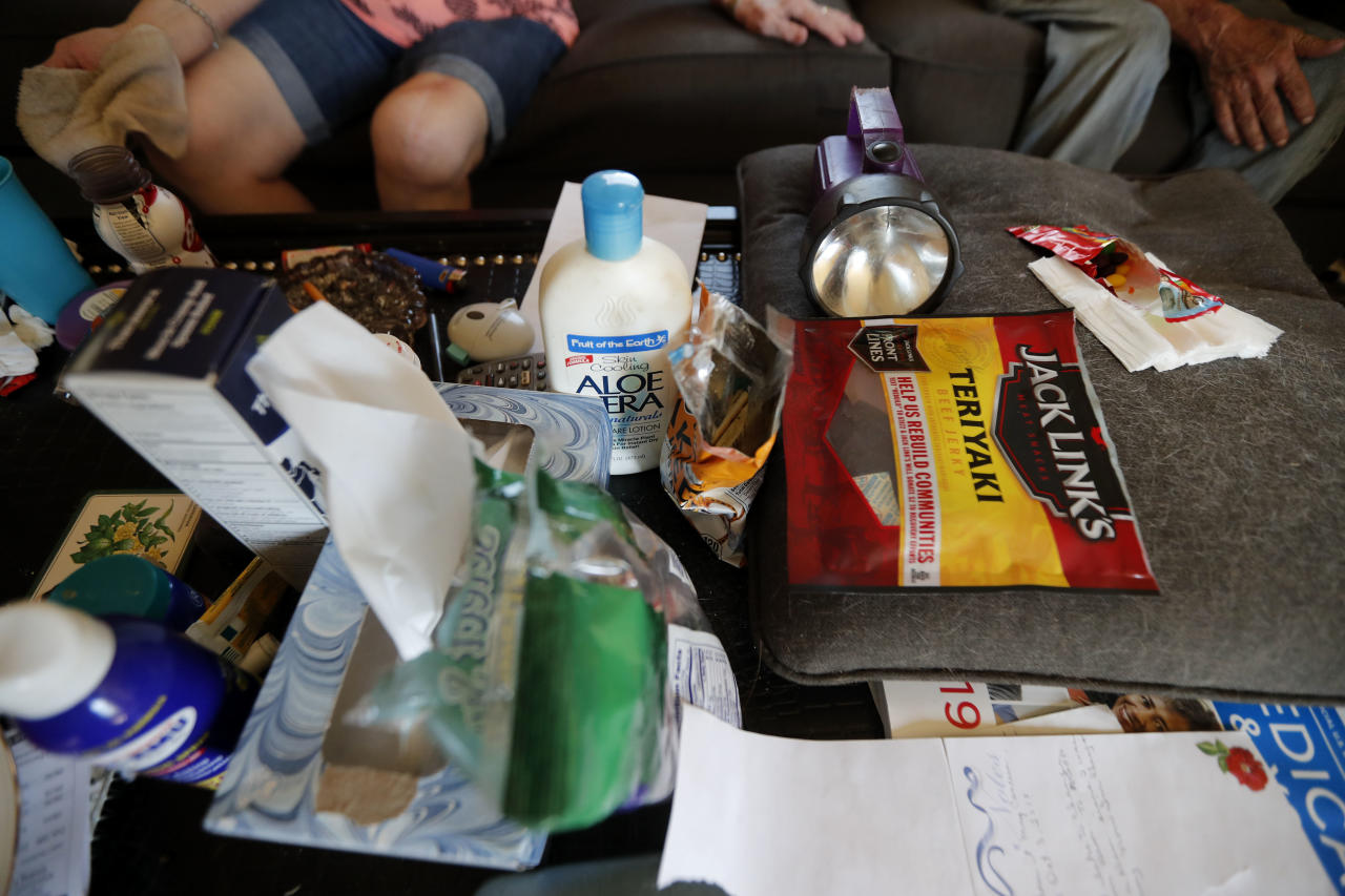 Survival supplies sit on the coffee table of Ed Kirkpatrick and his wife Sandra Sheffield, in the aftermath of Hurricane Michael in Panama City, Fla., Wednesday, Oct. 17, 2018. The elderly couple, both of whom have health issues, refuse to leave their home, which has no electricity. (AP Photo/Gerald Herbert)