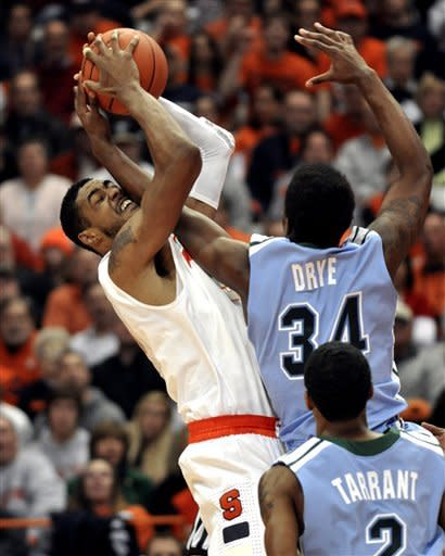 Syracuse's Fab Melo, left, grabs a loose ball from Tulane's Trevante Dyre (34) during the first half of an NCAA college basketball game in Syracuse, N.Y., Thursday, Dec. 22, 2011. (AP Photo/Kevin Rivoli)
