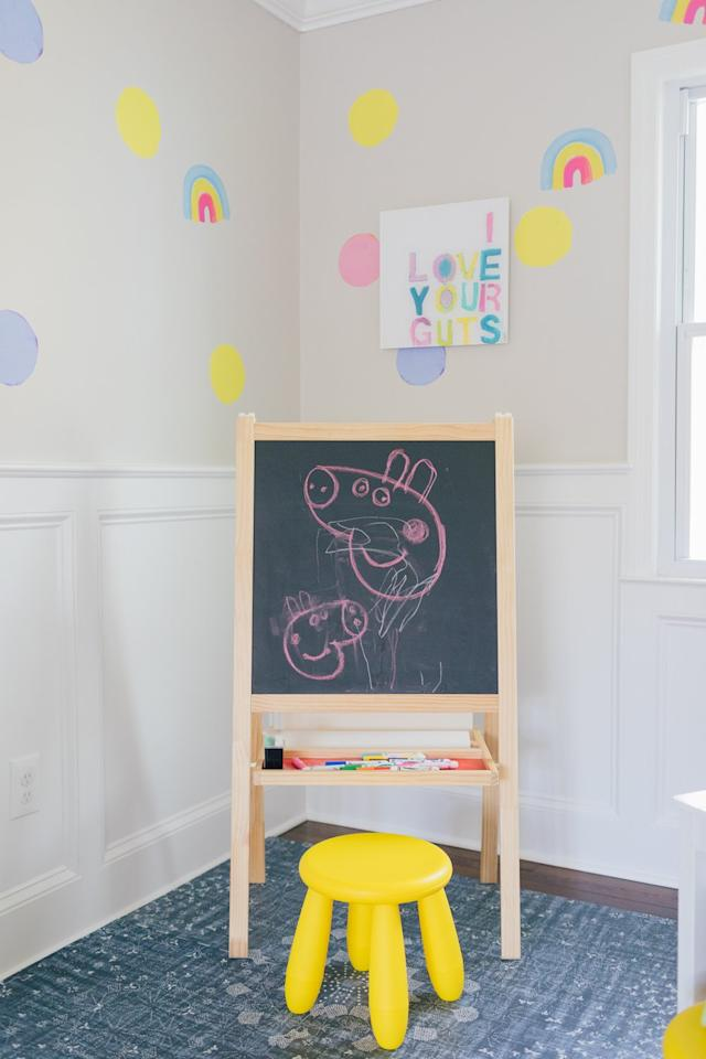 """<p>If even removable wallpaper feels like too much, take a cue from blogger and busy mom, Julia Dzafic of <a href=""""http://lemonstripes.com/decor/paperless-wallpaper/"""" target=""""_blank"""">Lemon Stripes</a>. She used peel-and-stick <a href=""""https://www.kerrirosenthal.com/collections/paperless-wallpaper"""" target=""""_blank"""">Paperless Wallpaper from Kerri Rosenthal</a>, small decals that can simply be stuck to your walls to give the look of wallpaper without the installation time. Apply it in a grid pattern or just stick them wherever they look good. In shapes like painted dots, hearts, or palm trees, there's something for every taste.</p> <p><strong>RELATED: <a href=""""https://www.realsimple.com/home-organizing/decorating/wallpaper-designs"""" target=""""_blank"""">24 Modern Wallpaper Designs Guaranteed to Transform Your Space</a></strong></p>"""