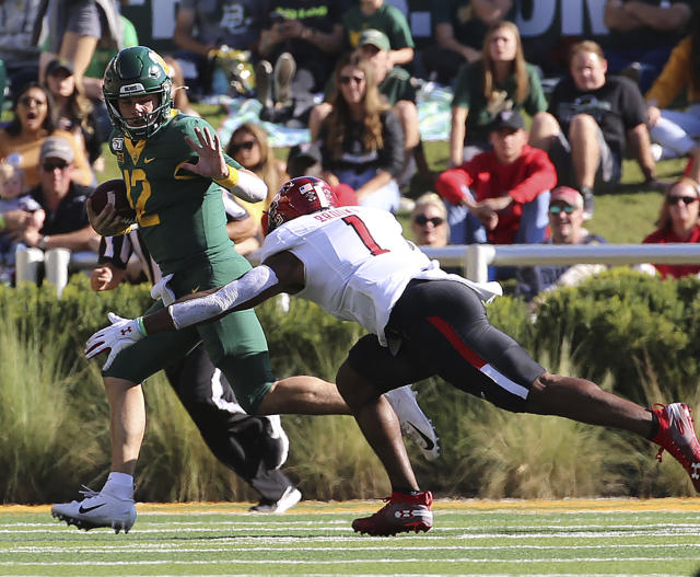 Baylor quarterback Charlie Brewer (12) runs by Texas Tech linebacker Charlie Brewer (1) during the first half of a NCAA college football game in Waco, Tex.,Saturday, Oct. 12, 2019.(AP Photo/Jerry Larson)