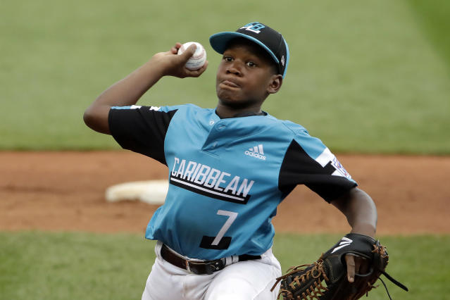 Curacao's Keven Rosina delivers during the second inning of the Little League World Series Championship game against River Ridge, Louisiana, in South Williamsport, Pa., Sunday, Aug. 25, 2019. (AP Photo/Gene J. Puskar)