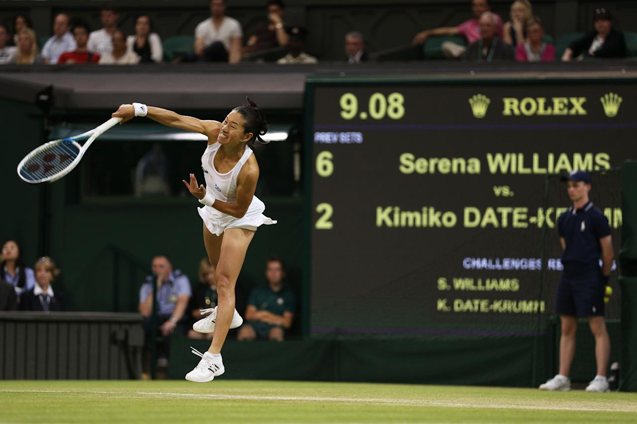 LONDON, ENGLAND - JUNE 29: Kimiko Date-Krumm of Japan serves during the Ladies' Singles third round match against Serena Williams of the United States of America on day six of the Wimbledon Lawn Tennis Championships at the All England Lawn Tennis and Croquet Club on June 29, 2013 in London, England. (Photo by Clive Brunskill/Getty Images)