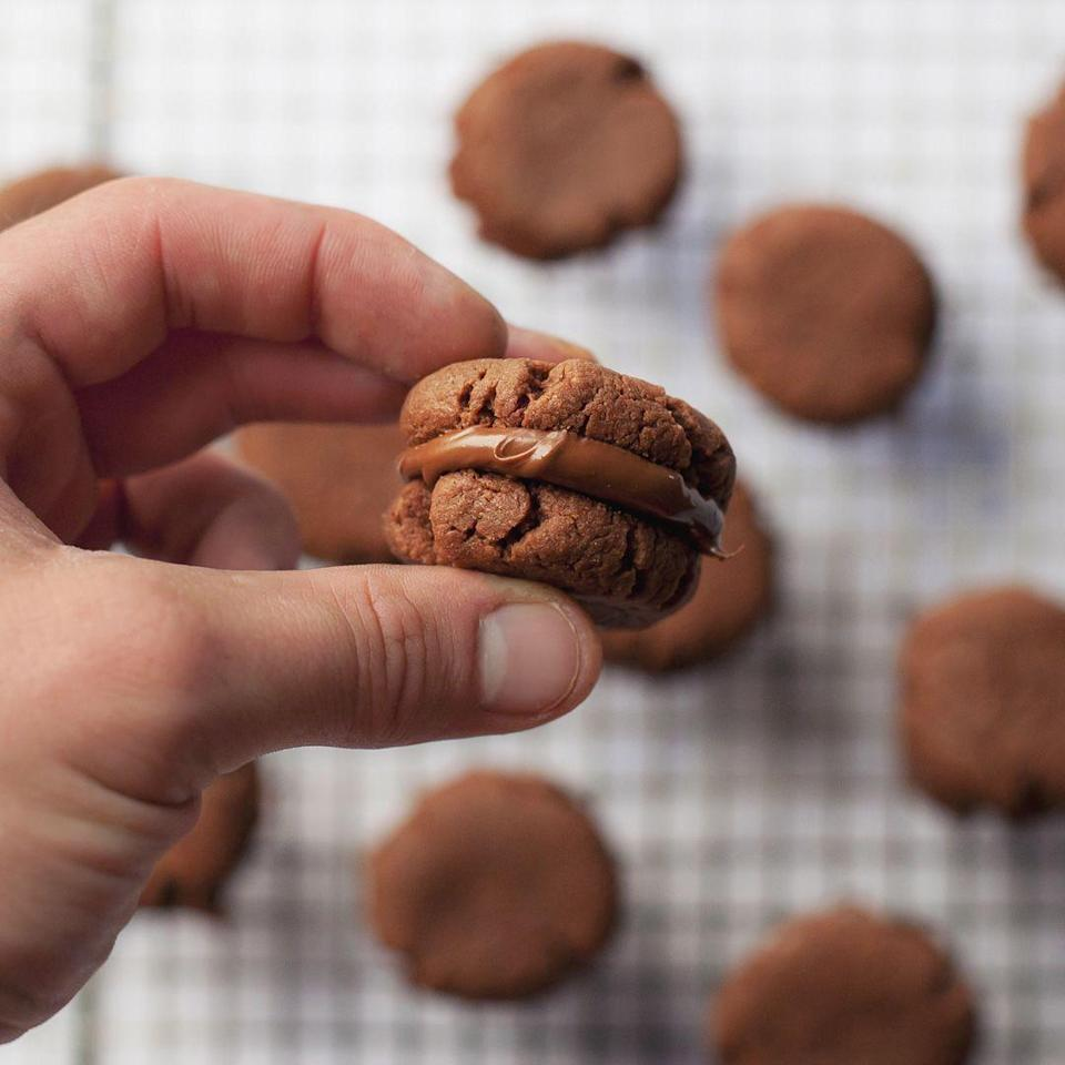 """<p>Simply stir together 3 ingredients to make these super easy cookies.</p><p><strong>Recipe: <a href=""""https://www.goodhousekeeping.com/uk/food/recipes/a33543216/3-ingredient-nutella-sandwich-cookies/"""" rel=""""nofollow noopener"""" target=""""_blank"""" data-ylk=""""slk:Nutella Sandwich Cookies"""" class=""""link rapid-noclick-resp"""">Nutella Sandwich Cookies</a></strong></p>"""