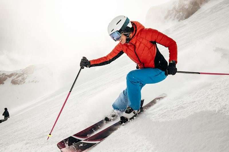 A person skiing while wearing an Apple Watch.
