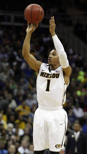Missouri Tigers guard Phil Pressey (1) shoots a 3-point basket during the first half of an NCAA college basketball game against Texas in the Big 12 Conference tournament Friday, March 9, 2012, in Kansas City, Mo. (AP Photo/Orlin Wagner)