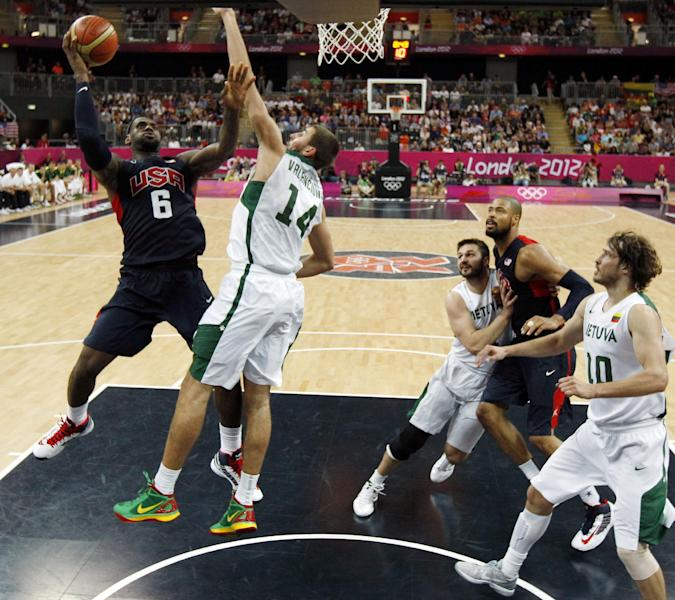 United States' Lebron James (6) shoots over Lithuania's Jonas Valanciunas (14) during their men's preliminary round basketball game at the 2012 Summer Olympics on Saturday, Aug. 4, 2012, in London. (AP Photo/Sergio Perez, Pool)
