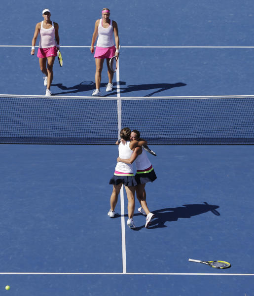 Italy's Roberta Vinci, right, and Sara Errani celebrate after winning the women's doubles match final against Andrea Hlavackova, above left, and Lucie Hradecka, both of the Czech Republic, at the 2012 US Open tennis tournament, Sunday, Sept. 9, 2012, in New York.(AP Photo/Darron Cummings)