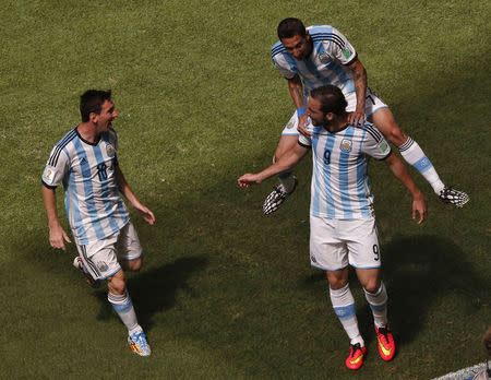 Argentina's Gonzalo Higuain celebrates with his teammates Angel Di Maria and Lionel Messi after scoring. REUTERS/David Gray