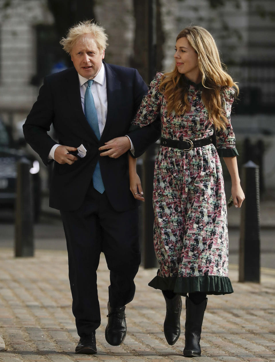 FILE - In this Thursday May 6, 2021, file photo, British Prime Minister Boris Johnson arrives at a polling station with his partner Carrie Symonds to cast his vote in local council elections in London. U.K. newspapers are reporting that Prime Minister Johnson and his fiancée Symonds married Saturday, May 29, 2021, in a small private ceremony in London. The Mail on Sunday and the Sun said the couple wed at the Roman Catholic Westminster Cathedral in front of a small group of friends and family. (AP Photo/Matt Dunham, File)